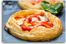 Buttery cheese and tomato mini pizzas recipe